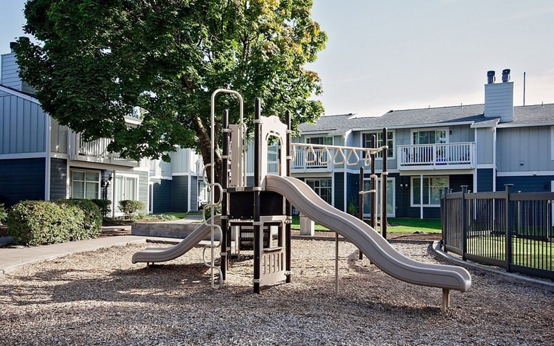 outdoor playground with slides and climbing equipment