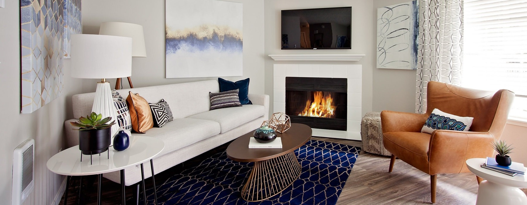 fireplace in brightly lit living room